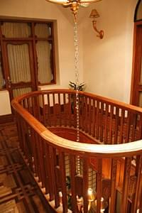 An oval railing fence on the third floor signifies a shipping theme in the Moller Villa's architectural detailing; Photo by Wang Zhiyong/China.org.cn