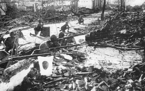 Picture source:Wikipedia; Japanese soldiers in the ruins of Shanghai