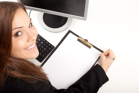 Picture Of Woman Completing Intuitive Bodywork Client Intake Form