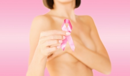 Woman Holding Pink Ribbon - Lymphatic Breast Massage Intake Form
