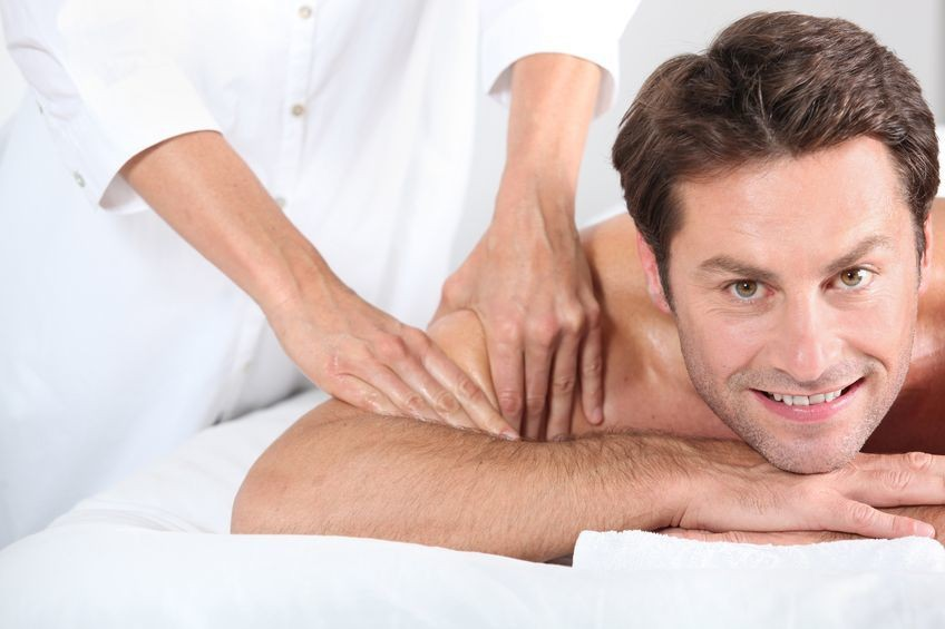 Man Getting A Shoulder Massage