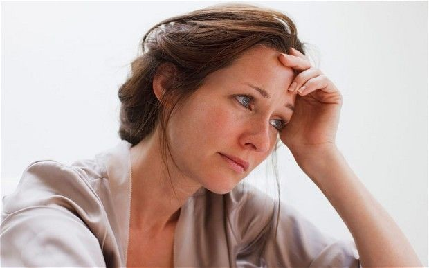 Stressed Woman With Hand On Head