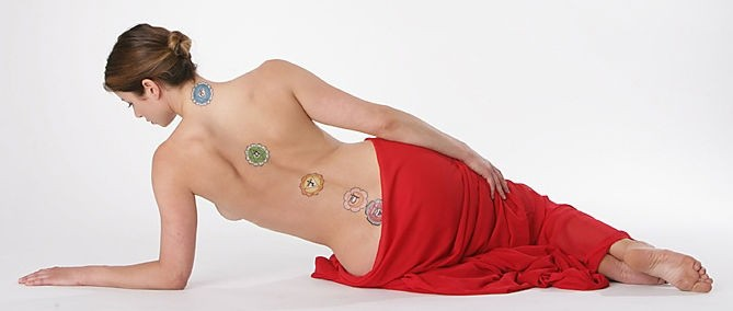 Woman Laying On Side With Chakras Painted On Her Back