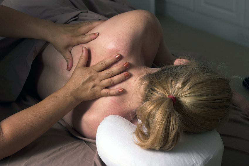Woman Receiving Prenatal Massage And-Energy-Work In A Side-Laying-Position