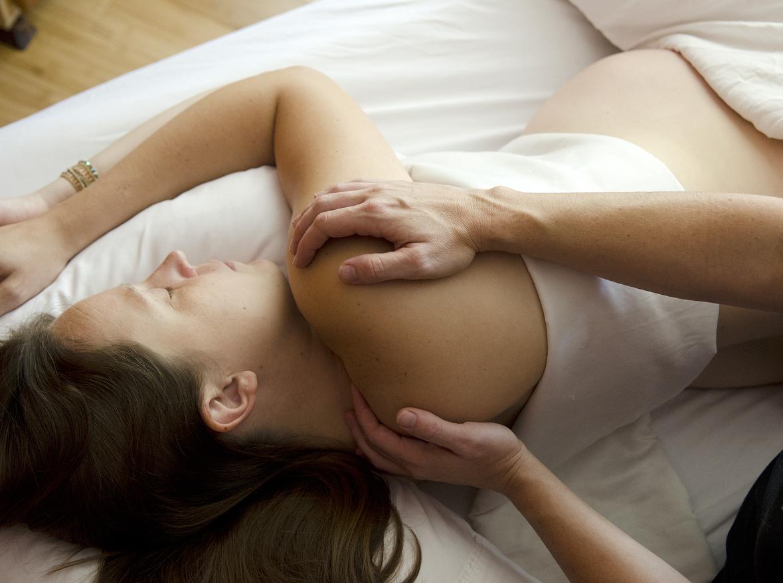Pregnant Woman Recieving Reiki, Energy Work and Chakra Balancing