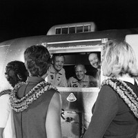 S69-40147 Apollo 11 astronauts, still in their quarantine van, are greeted by their wives upon arrival at Ellington Air Force Base July 27, 1969