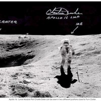 This Panorama from left to right shows Flag and Plum Craters, then rather bizarely we see Charlie Duke twice! This was because he was moving as John Young was capturing the panorama. Then to the right we see Stone Mountain in the background and South Ray Crater beyond to the far right.
