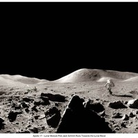 This Panorama was captured by Gene Cernan and while it looks black and white, is actually in color. It shows the beautiful Taurus Littrow Valley, with to the left, Camelot Crater and in the middle, Harrison Schmitt can be seen bounding over towards the Lunar Rover Hand signed by Apollo 17 Commander Gene Cernan