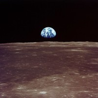 AS11-44-6550  Earthrise viewed from lunar orbit prior to landing