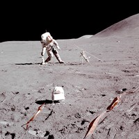 Apollo 15 CDR Gene Dave Scott picking up a drill close to the ALSEP Site