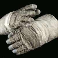 These gloves worn by Gene Cernan for Apollo 17 were constructed of an outer shell of Chromel-R fabric with thermal insulation to provide protection while handling extremely hot or cold objects. The blue fingertips were made of silicone rubber to provide sensitivity
