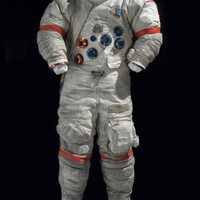 Cernan's Spacesuit from Apollo 17 This suit is a more advanced version of the type worn by Apollo 11 astronauts Armstrong and Aldrin. It contains a layer of aluminized, gridded Kapton film for additional protection.