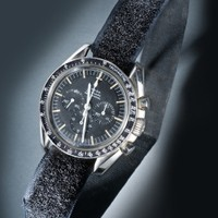 NASA issued this Omega Speedmaster chronograph to astronaut Neil Armstrong for use during the Apollo 11 mission of July 1969.  Selected after a series of rigorous tests demonstrated its high level of precision and reliability, the Speedmaster chronograph was chosen by NASA for the U.S. space program in 1964. Program requirements called for a manual-winding wrist chronograph that was water-proof, shock-proof, anti-magnetic, able to withstand temperatures ranging from 0 to 200 degrees Farenheit, and accelerations of up to 12 g's. NASA first certified the Omega Speedmaster as the chronograph for the Gemini program and made successive purchases for both the Apollo and the Skylab/ASTP missions.  Transferred from NASA in 1973.  Transferred from the National Aeronautics and Space Administration