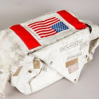 This Oxygen Purge System Cover  is from Gene Cernan's Apollo 17 PLSS unit. The only one ever returned from the Moon, it is covered with Moon dust.