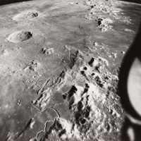 US$ 500  APOLLO 15 LANDING SITE SEEN FROM ORBIT Large black and white photograph, 11 x 14 inches.  Details from a Hasselblad frame taken while in lunar orbit showing the Apollo 15 landing site with the long winding track of Hadley Rille surrounded by the rugged Hadley and Apennine Mountains.