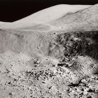 US$ 750 APOLLO 17 LUNAR SURFACE VIEW—SHORTY CRATER THE SITE OF THE ORANGE SOIL DISCOVERY  Large black and white photograph, 11 x 14 inches.   Details from Hasselblad frame A17-137-21001 taken during the second Apollo 17 surface exploration, viewing the boulders and walls of Shorty Crater at Station Stop 4. Orange soil was found along the rim of Shorty Crater.
