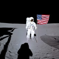 Apollo 14 LMP Edgar Mitchell posing next to the Stars and Stripes