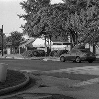 Street and cars, Tyler, Texas; Pentax Spotmatic SP w/ 55mm f1.8 lens, Ca. 1965; Ilford FP4 35mm film, developed in Kodak HC110 developer, Dil. H.