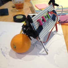 DrawBot playing with orange