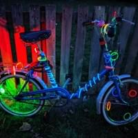 Outdoor party in Cambridge UK on bikes. Creatively decorated bike.