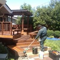 A deck in process of being stained & sealed.
