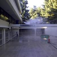 Commercial pressure washing a parking garage.