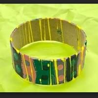 Bangle: Recycled Cardboard Tube made into wearable Art after painting with Color Theory design