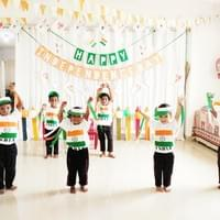 Kids shake a leg and their hands on Independence Day.