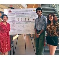 Tara, Alix, and Ashwin presenting some hypothesized results patterns from a current project