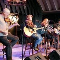 Robin James onstage with Don Richmond and others  in Taos, New Mexico