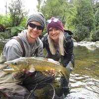 Angler Tyler Yost and wife Jen with a brown trout caught from the tail of the pool pictured