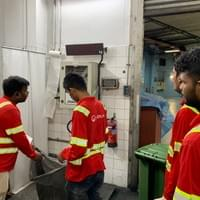 Waste collection team recording weight of event waste.