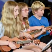 Campers working on some ukulele tunes