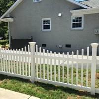 Scalloped White Vinyl Fence