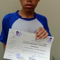 Carlos with his certificate