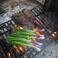 Grilled porterhouse and spring onions