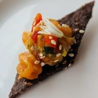 Salmon Poke, wild onion, black rice cracker