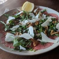 Beef Carpaccio, fried artichokes, arugula and Parmigiano