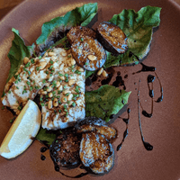 Fig leaf wrapped and grilled local halibut, figs and balsamico