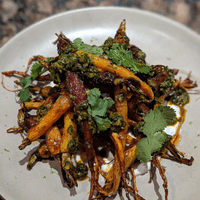 Harissa honey glazed carrots, chermoula, preserved lemon yogurt