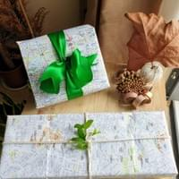 Gifts wrapped in maps of Berlin and Malaga. See if you can find the Brandenburg Gate and Jardines de Picasso on the maps. Photo by M Negash.