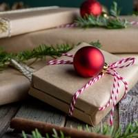 Gifts wrapped in brown paper. Photo by Mel Poole on Unsplash.