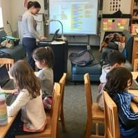 One of our instructors teaching coding with Scratch