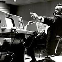 Kraft works at his console inside the Flight Control area of the Mercury Control Center