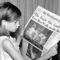 """This is a picture of my mother holding the Washington News Paper on Monday, July 21st 1969 stating 'The Eagle Has Landed Two Men Walk on the Moon'. The photo was taken by my grandfather Jack Weir (1928-2005)"""