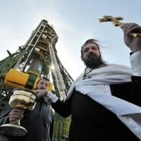 A Russian Orthodox priest blesses the Soyuz TMA-18 spacecraft at Baikonur Cosmodrome on April 1, 2010. (VYACHESLAV OSELEDKO/AFP/Getty Images)