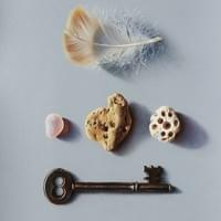 Feather,keys,stones