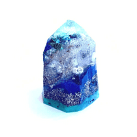 "Emily Budd Memory Gem to Ralfy Olivas, gift for his mother Alma Chavez, 2021 Sand and shells collected by Alma and Ralfy in Hawaii, in cast resin. 3"" x 2"" x 1 ½"" NFS 