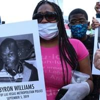 "Marcia Wells, niece of Byron Williams, joins other members of Families United 4 Justice Las Vegas - a local group of police brutality survivors and police homicide survivors - in downtown Las Vegas to protest the police murder of George Floyd.  Byron Williams was ""cycling while Black,"" when he was apprehended for allegedly not having  a safety light on his bicycle in the early morning of September 5, 2019.  Despite surrendering and being unarmed, the interaction caused him to lose his life.  May 30, 2020, Las Vegas, NV.  Photo by Nissa Tzun, Forced Trajectory Project."