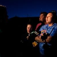 At a vigil for Junior Lopez, Amber Bustillos, Junior's fiancée, interviews with Fox 5 News, alongside Junior's stepfather, Jorge Luis Martinez, and friend Kimberly Gonzalez. Amber and Kimberly witnessed the police shooting of Junior early Friday morning in East Las Vegas on Charleston Boulevard and Madge Lane, April 9, 2018, Las Vegas, NV.  Photo by Nissa Tzun, Forced Trajectory Project.